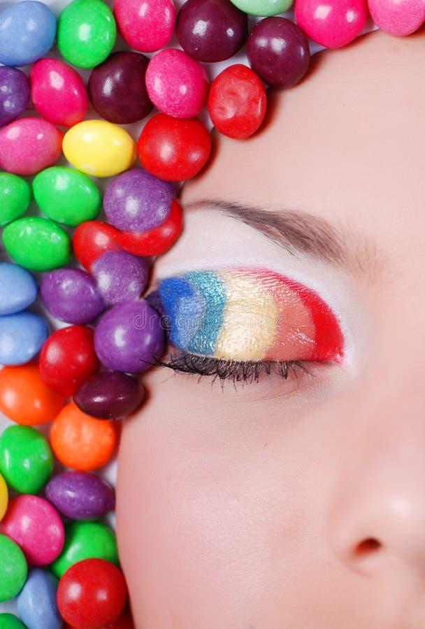 Het meisje van de schoonheid in suikergoed stock afbeelding
