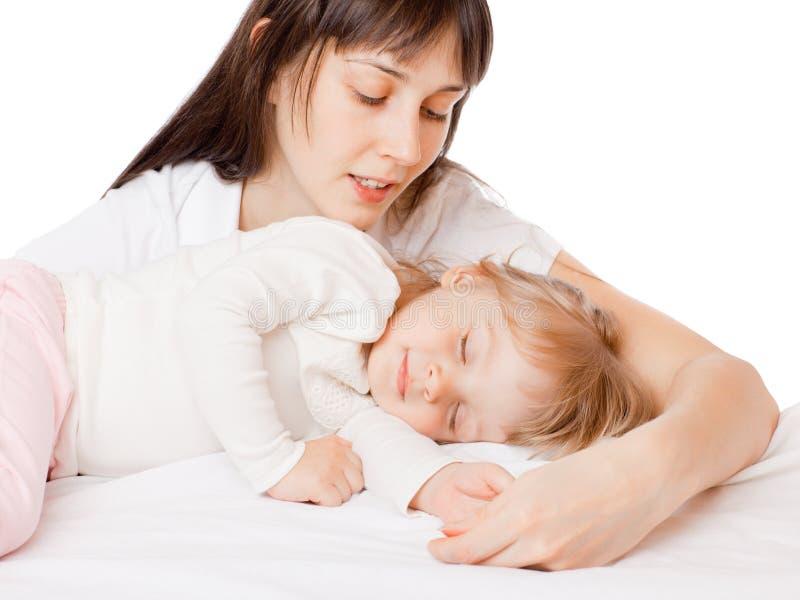Het meisje van de slaap met mamma stock afbeeldingen