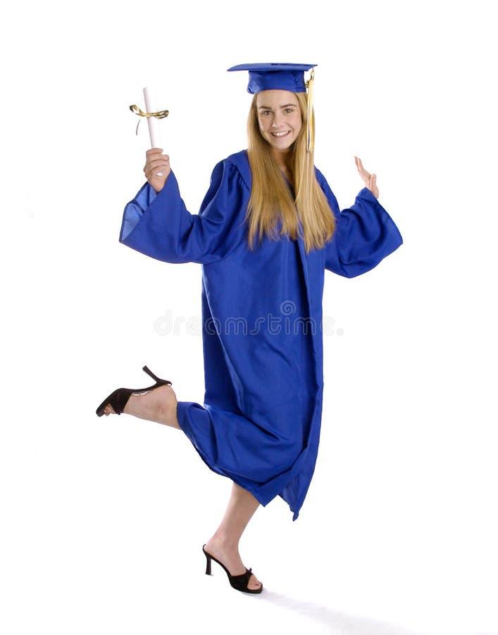 Het meisje van de tiener in graduatietoga het dansen stock foto's