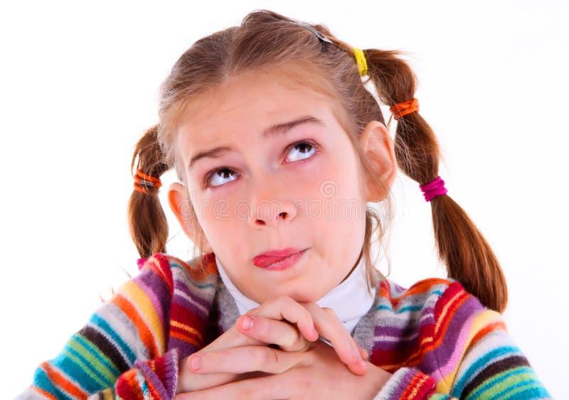 Het meisje van de tiener maakt gekke grappige gezichten royalty-vrije stock afbeeldingen