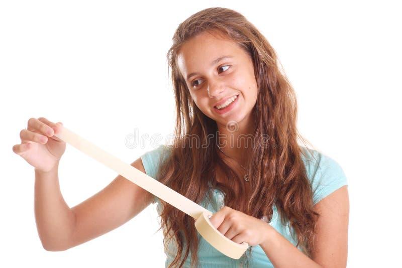 Het meisje van de tiener met afplakband stock afbeeldingen