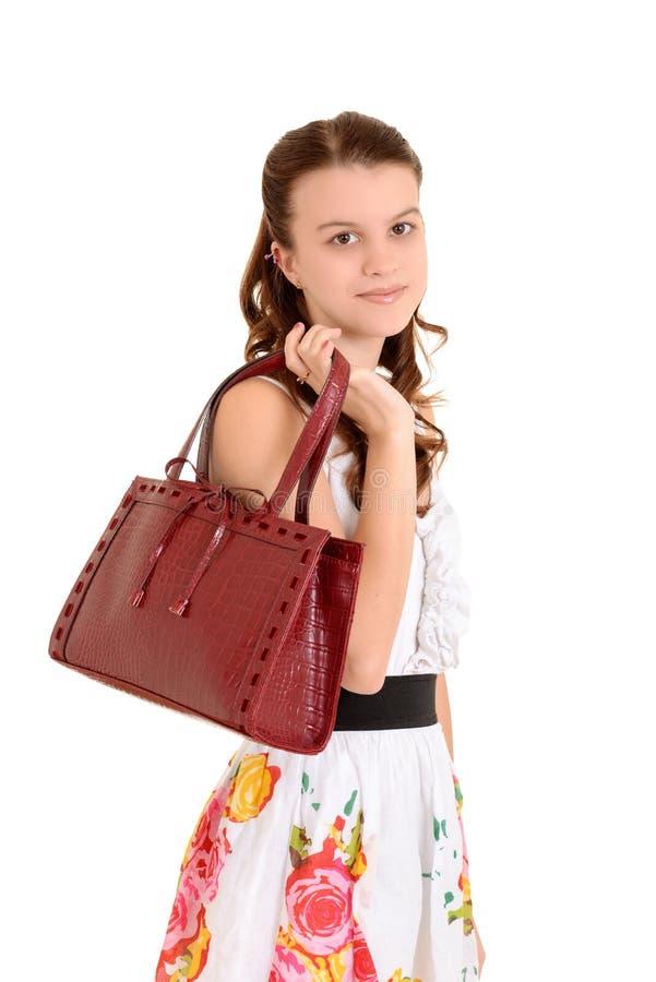 Het meisje van de tiener met beurs royalty-vrije stock afbeeldingen
