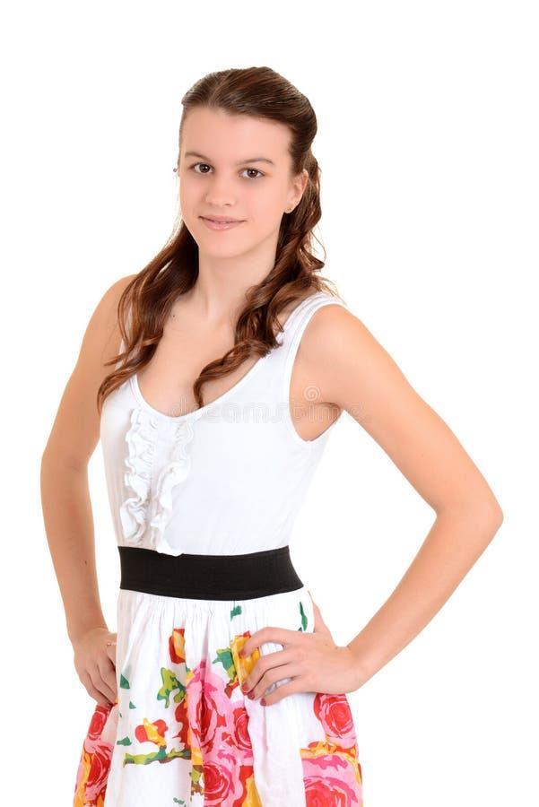 Het meisje van de tiener met handen op heupen stock foto