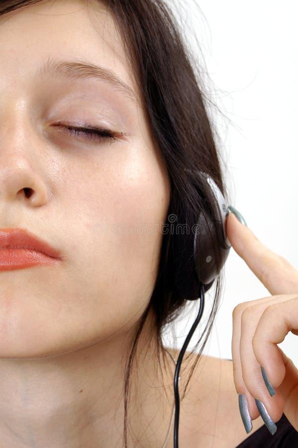 Het meisje van de tiener met hoofdtelefoons stock afbeelding