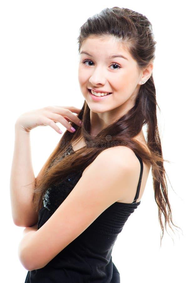 Het meisje van de tiener met lang haar op geïsoleerd wit stock afbeelding