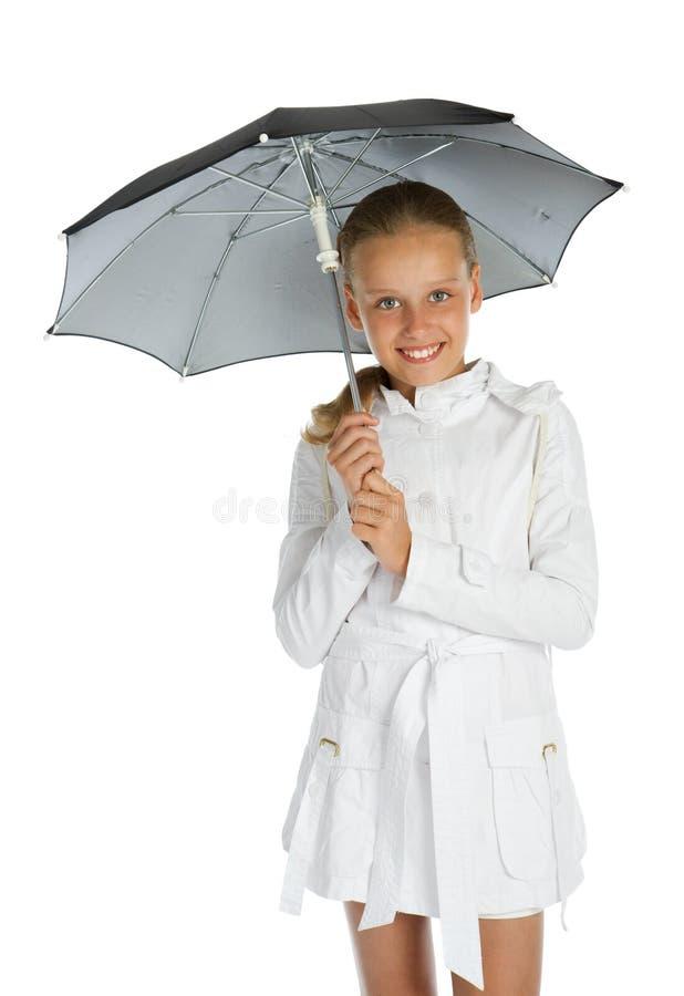 Het meisje van de tiener met paraplu stock fotografie
