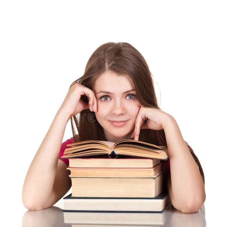 Het meisje van de tiener met partij van boeken stock afbeelding