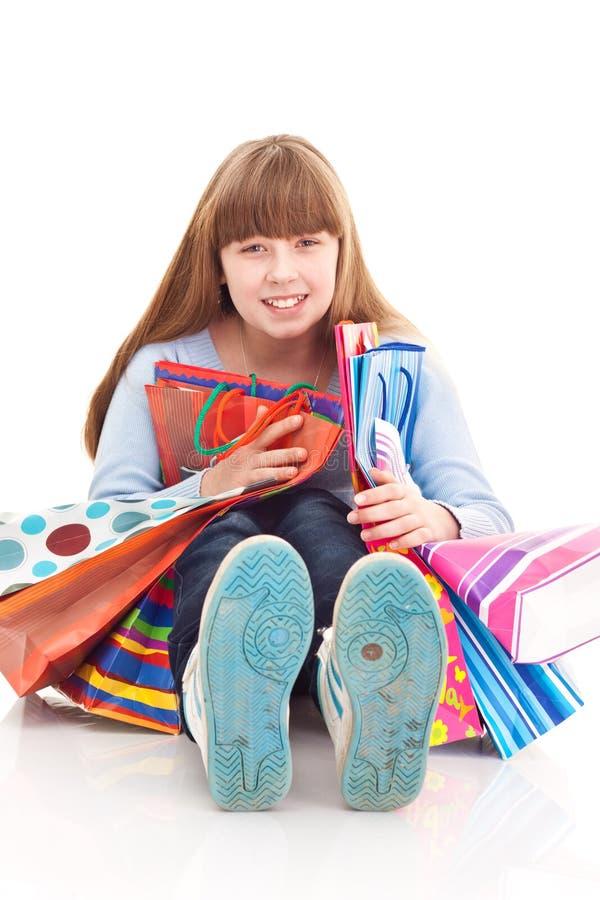 Het meisje van de tiener met zakken stock fotografie