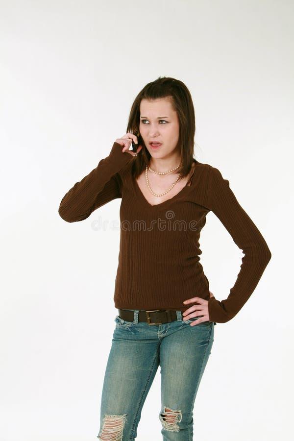 Het meisje van de tiener op telefoon royalty-vrije stock fotografie