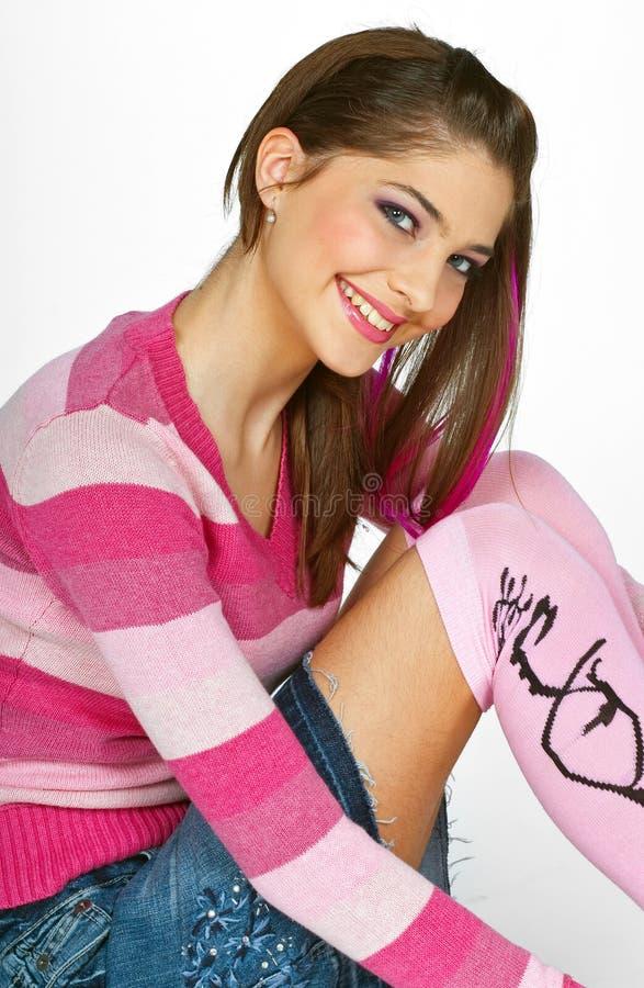 Het meisje van de tiener in roze stock foto