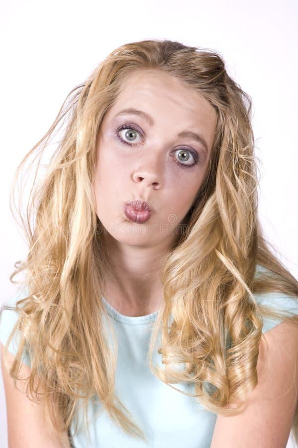 Het meisje van de uitdrukking het kussen royalty-vrije stock foto's