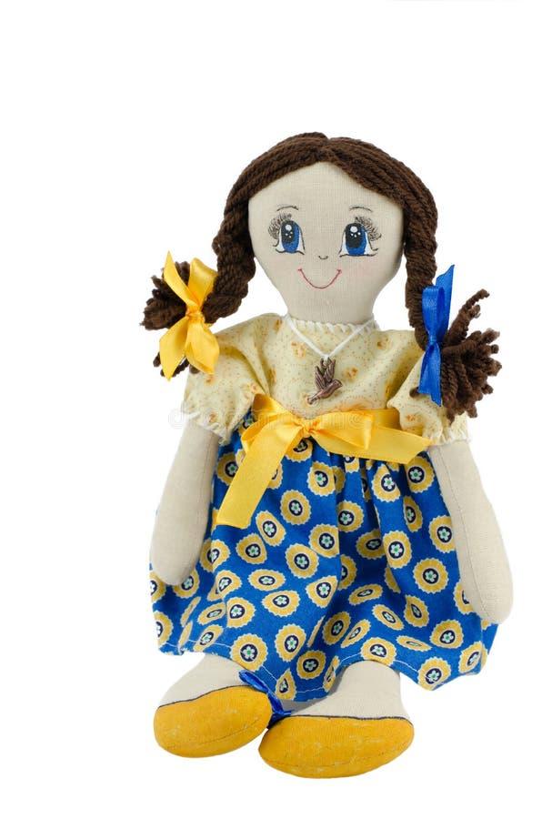 Het meisje van de voddenpop met bruin haar kleedde zich in patriottische Oekraïense kleuren royalty-vrije stock fotografie