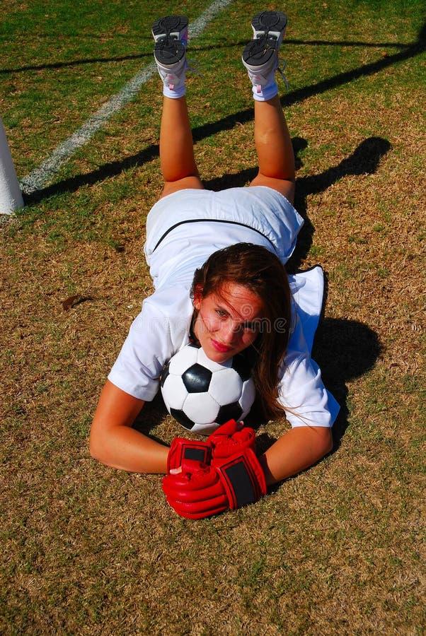 Het meisje van de voetbal stock afbeeldingen