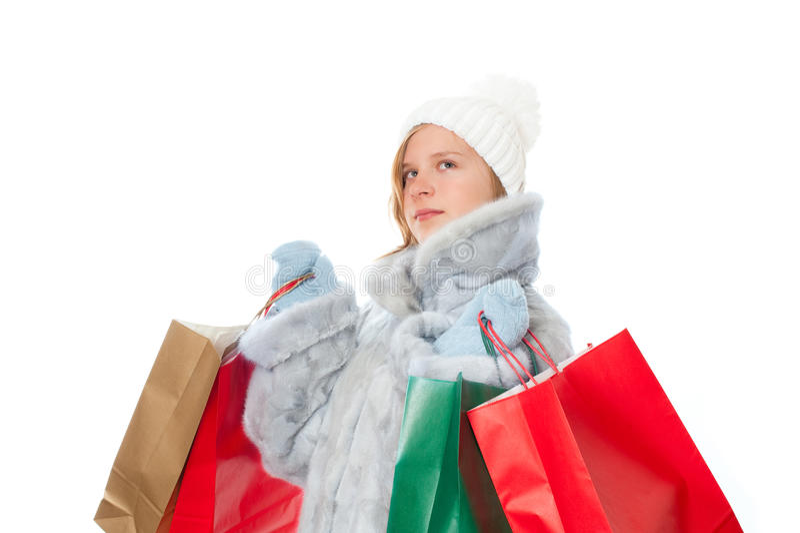Het meisje van de winter met giftzakken stock afbeeldingen