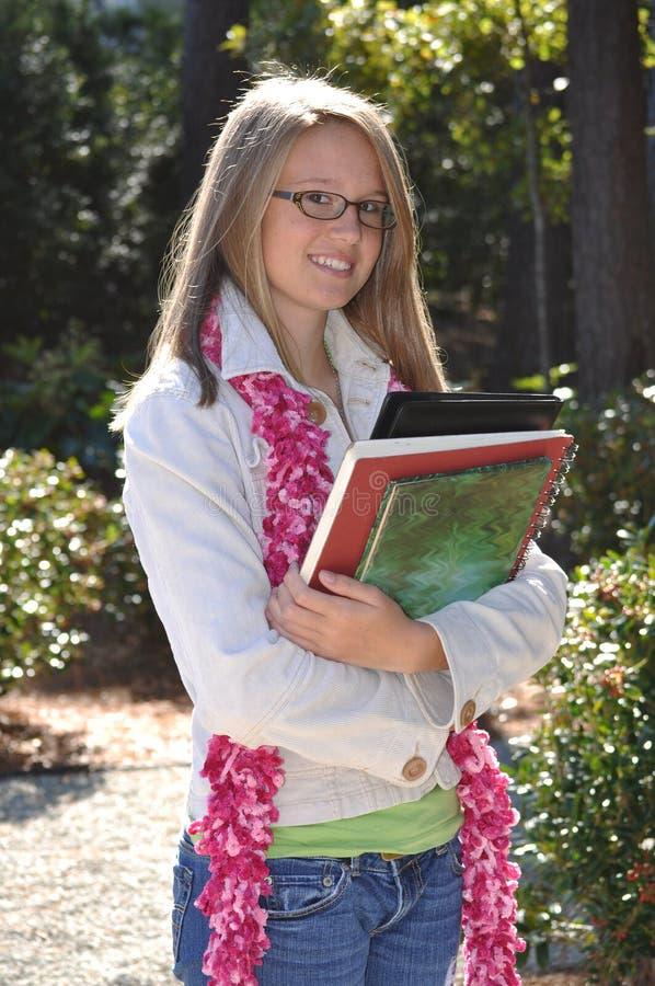 Het Meisje van het Haar van de blonde met Boeken stock afbeelding