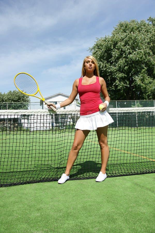 Het meisje van het tennis stock foto's
