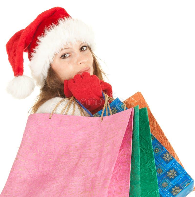Het meisje van Kerstmis dragende het winkelen zakken royalty-vrije stock afbeeldingen