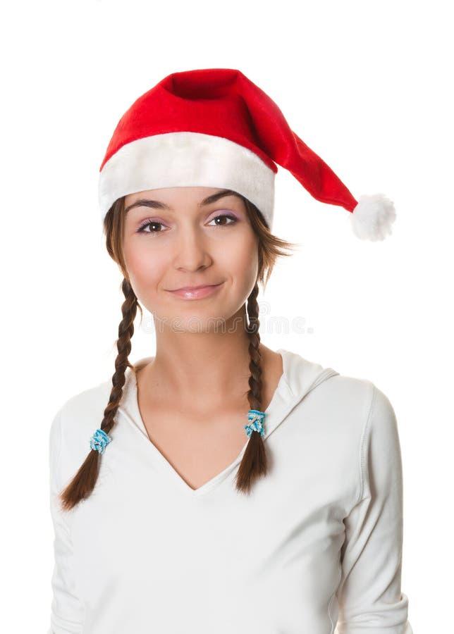 Het meisje van Kerstmis in santahoed royalty-vrije stock foto's