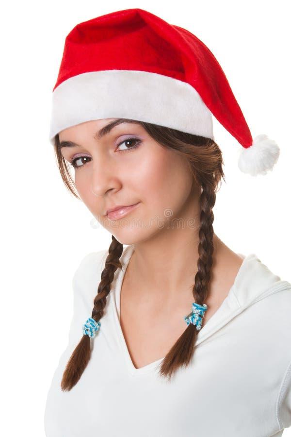 Het meisje van Kerstmis in santahoed stock afbeeldingen