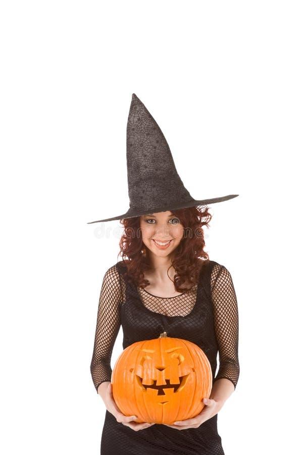 Het meisje van Teenaged in het kostuum van Halloween met pompoen royalty-vrije stock fotografie