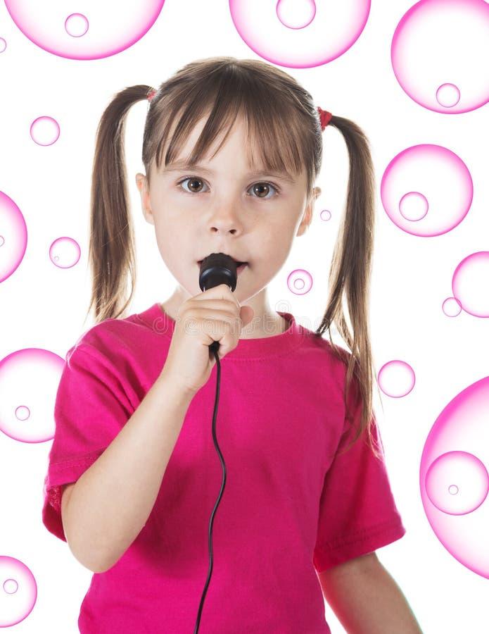 Het meisje zingt stock foto's