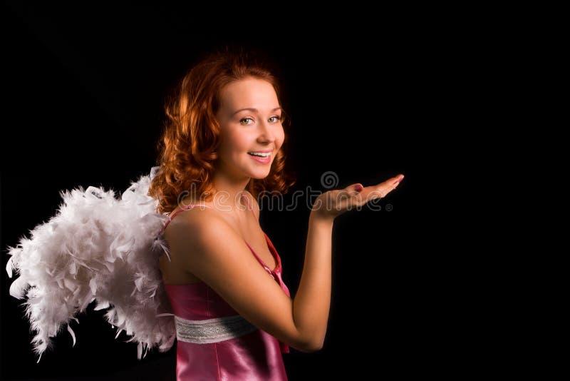 Het meisjesengel van de schoonheid in roze stock foto's