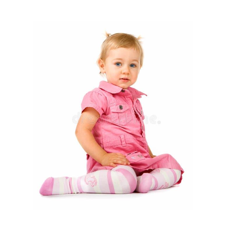 Het meisjeszitting van de baby royalty-vrije stock afbeeldingen