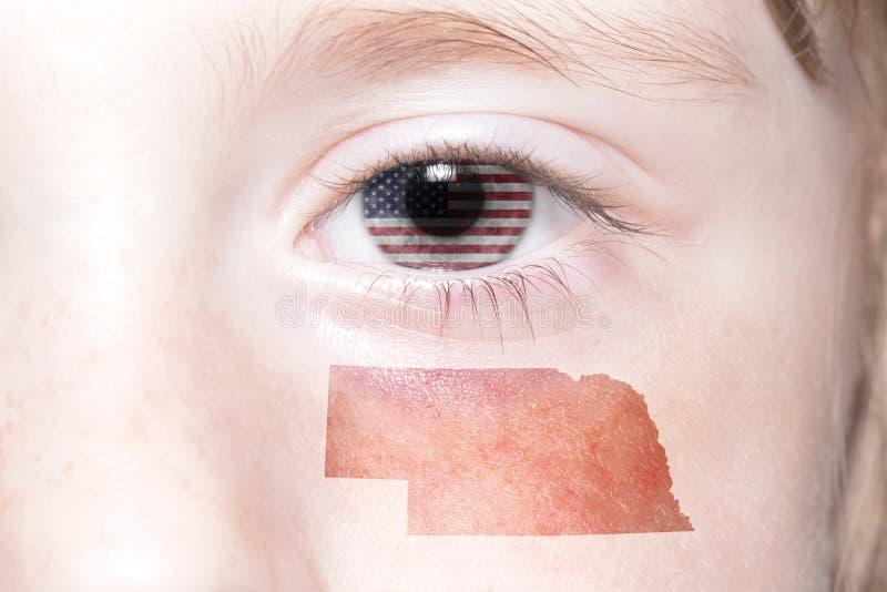 Het menselijke gezicht van ` s met nationale vlag van de Verenigde Staten van Amerika en Nebraska verklaren kaart royalty-vrije stock foto