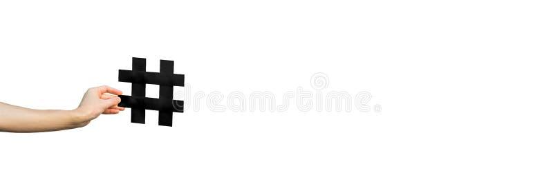 Het menselijke symbool van de handholding hashtag op achtergrondexemplaarruimte stock foto's