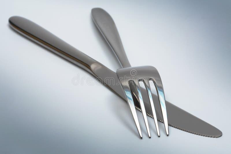 Het mes en de vork van het staal stock fotografie