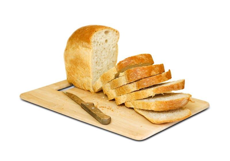 Het mes sneed Gouden brood Geïsoleerdj op witte achtergrond stock afbeeldingen