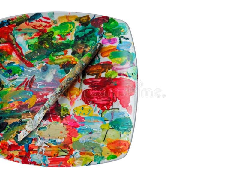 Het mes van de schilder op een palet stock afbeelding