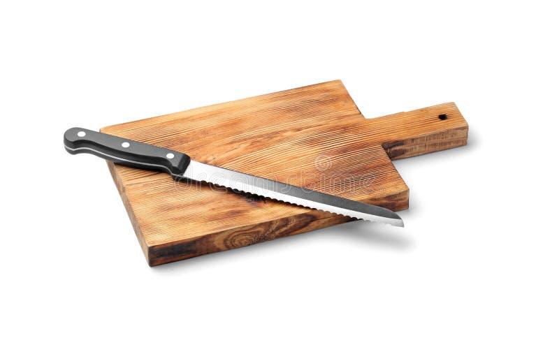 Het mes van het roestvrij staalbrood met plastic handvat aan boord stock foto