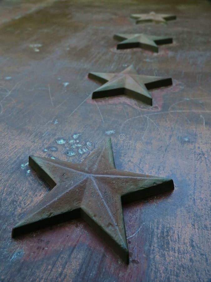 Het metaalachtergrond van de ster stock fotografie