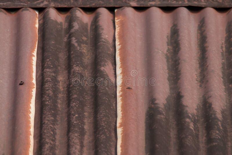 Het metaaltextuur van het dak roestige golfijzer stock afbeeldingen