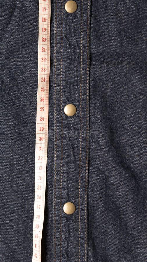 Het meten van band en Jean royalty-vrije stock afbeeldingen