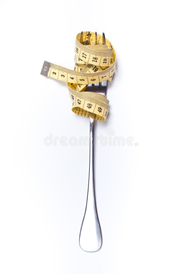 Het meten van band op een vorkconcept stock foto's