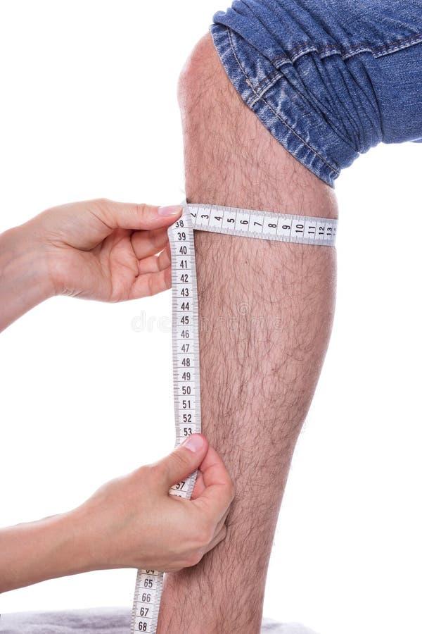Het meten van een been stock foto