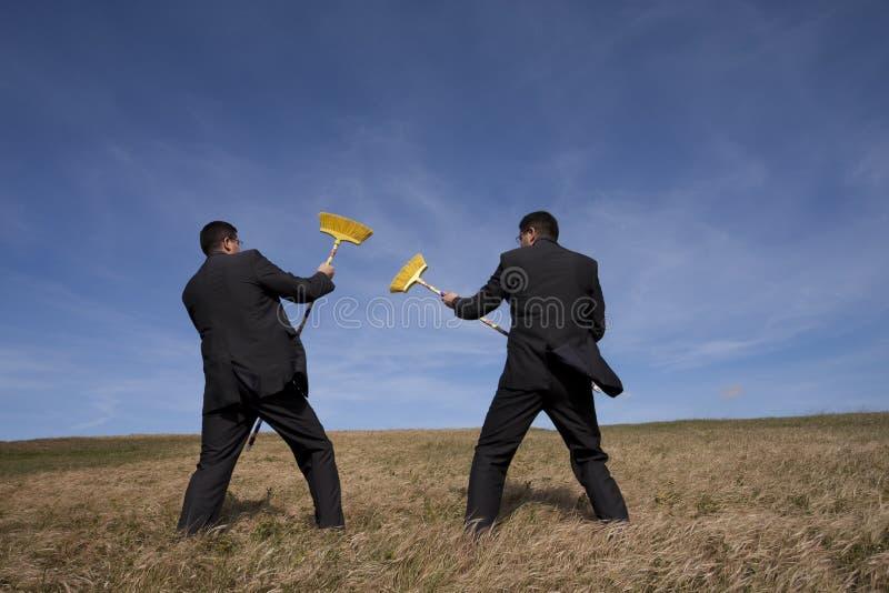 Het milieustrijd van de zakenman royalty-vrije stock foto's