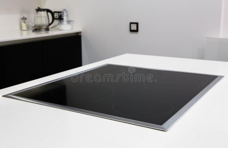 Het moderne kooktoestel van het inductie elektrische fornuis stock foto's