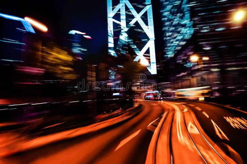 Het moderne onduidelijke beeld van de stadsmotie Hon Kong Abstract cityscape verkeer B stock foto's