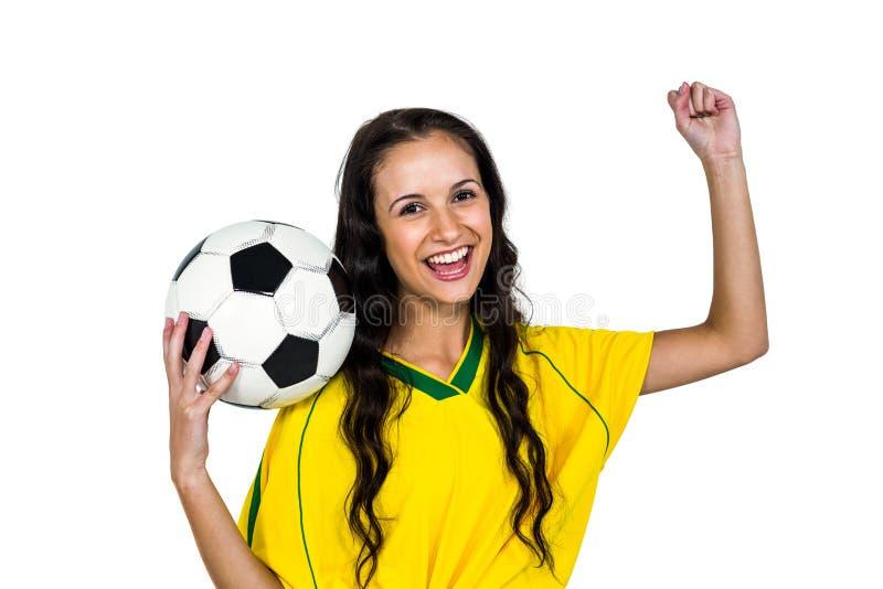 Het modieuze ondersteunende de voetbalbal van de vrouwenholding verheugen zich royalty-vrije stock foto