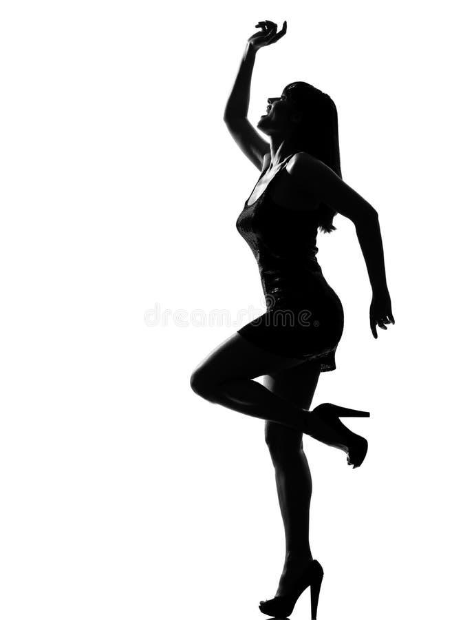 Het modieuze silhouetvrouw gelukkig dansen royalty-vrije stock afbeelding