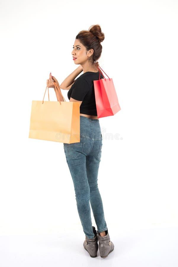 Het mooie atractive meisje winkelen royalty-vrije stock fotografie