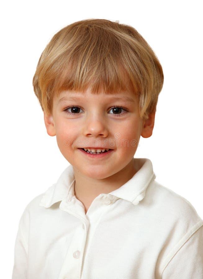 Het mooie blonde jongen glimlachen royalty-vrije stock foto