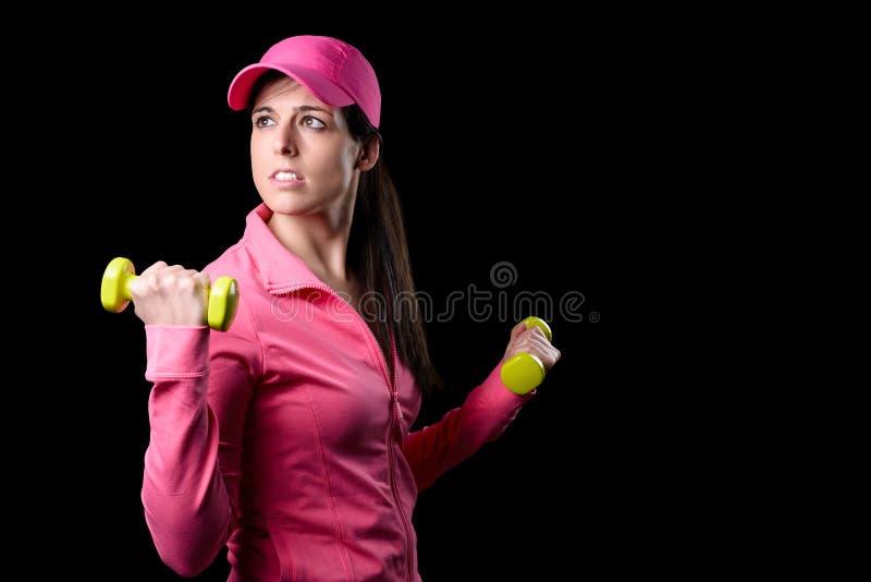 De vrouw die van de geschiktheid bicepsen uitwerken royalty-vrije stock afbeeldingen