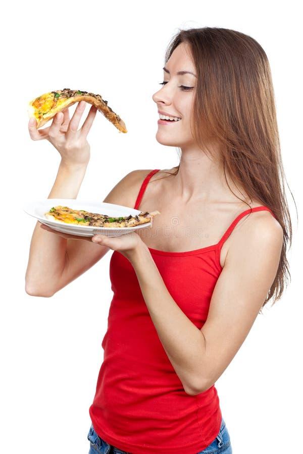 Het mooie donkerbruine stuk van de vrouwenholding van pizza stock foto's