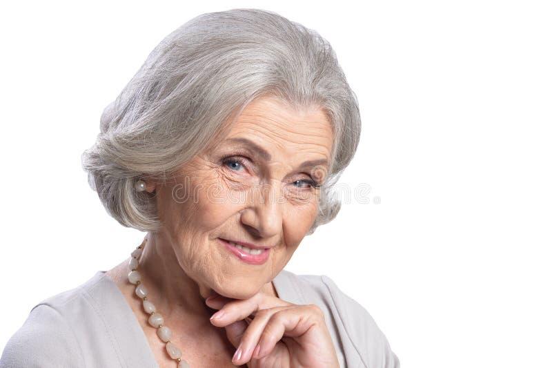 Het mooie hogere vrouw stellen op witte achtergrond royalty-vrije stock afbeeldingen