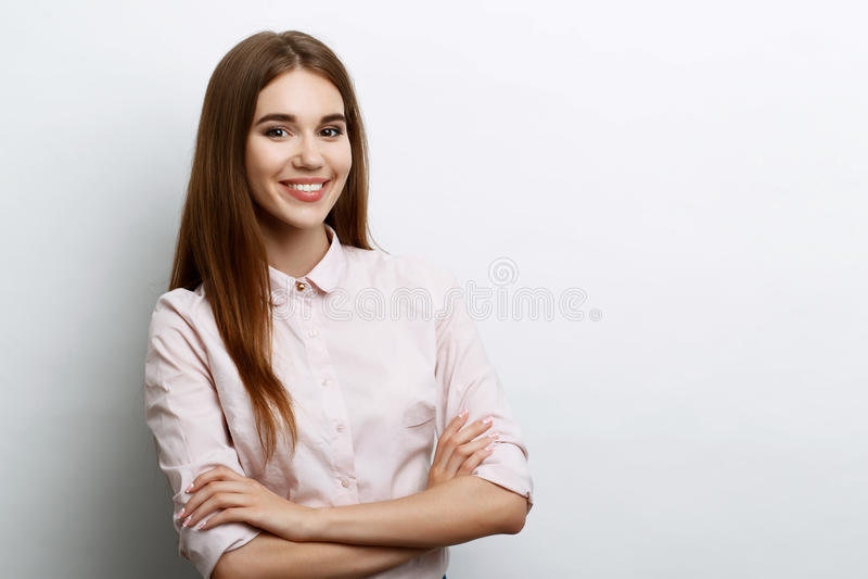 Het mooie jonge dame stellen stock foto's