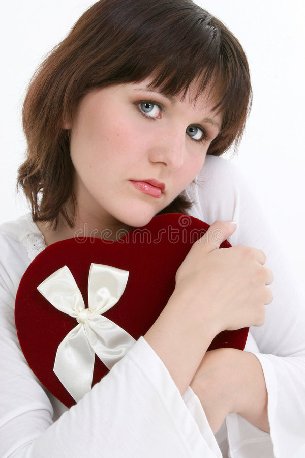 Het mooie Jonge Denken van de Vrouw aan Haar Valentijnskaart royalty-vrije stock afbeelding